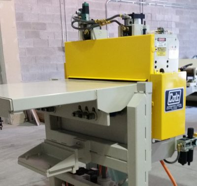 Colt Automation Feeder connecting to a press line for steel auto parts. Manual telescoping.